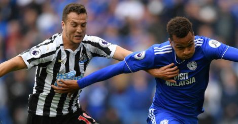 CARDIFF, WALES - AUGUST 18: Javier Manquillo of Newcastle United battles for possession with Josh Murphy of Cardiff City during the Premier League match between Cardiff City and Newcastle United at Cardiff City Stadium on August 18, 2018 in Cardiff, United Kingdom. (Photo by Dan Mullan/Getty Images)