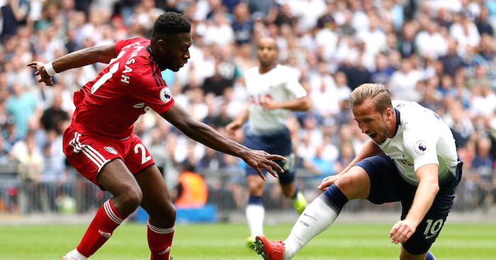 LONDON, ENGLAND - AUGUST 18: Harry Kane of Tottenham Hotspur is tackled by Timothy Fosu-Mensah of Fulham during the Premier League match between Tottenham Hotspur and Fulham FC at Wembley Stadium on August 18, 2018 in London, United Kingdom. (Photo by Dan Istitene/Getty Images)