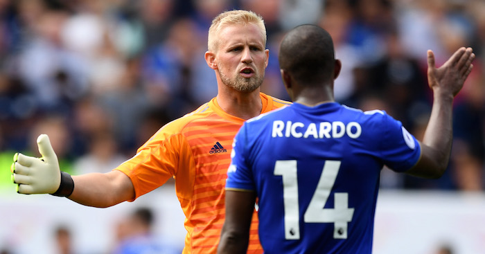 LEICESTER, ENGLAND - AUGUST 18: Kasper Schmeichel of Leicester City and Ricardo Pereira embrace during the Premier League match between Leicester City and Wolverhampton Wanderers at The King Power Stadium on August 18, 2018 in Leicester, United Kingdom. (Photo by Michael Regan/Getty Images)