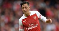 LONDON, ENGLAND - AUGUST 12: Mesut Ozil of Arsenal runs with the ball during the Premier League match between Arsenal FC and Manchester City at Emirates Stadium on August 12, 2018 in London, United Kingdom. (Photo by Shaun Botterill/Getty Images)