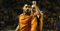 WOLVERHAMPTON, ENGLAND - JANUARY 02: Diogo Jota of Wolverhampton Wanderers celebrates with Ruben Neves of Wolverhampton Wanderers after scoring his team's 3rd goal during the Sky Bet Championship match between Wolverhampton and Brentford at Molineux on January 2, 2018 in Wolverhampton, England. (Photo by Gareth Copley/Getty Images)