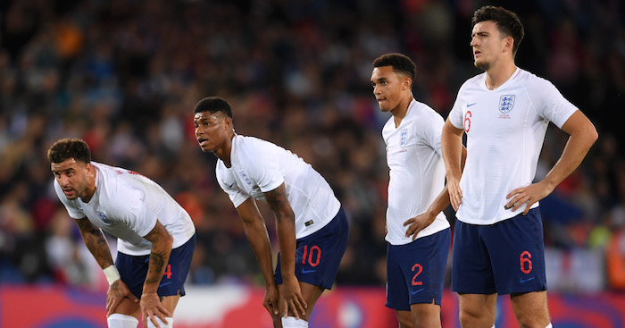 LEICESTER, ENGLAND - SEPTEMBER 11: (L-R) Kyle Walker, Marcus Rashford, Trent Alexander-Arnold and Harry Maguire of England assess a free kick during the international friendly match between England and Switzerland at The King Power Stadium on September 11, 2018 in Leicester, United Kingdom. (Photo by Laurence Griffiths/Getty Images)