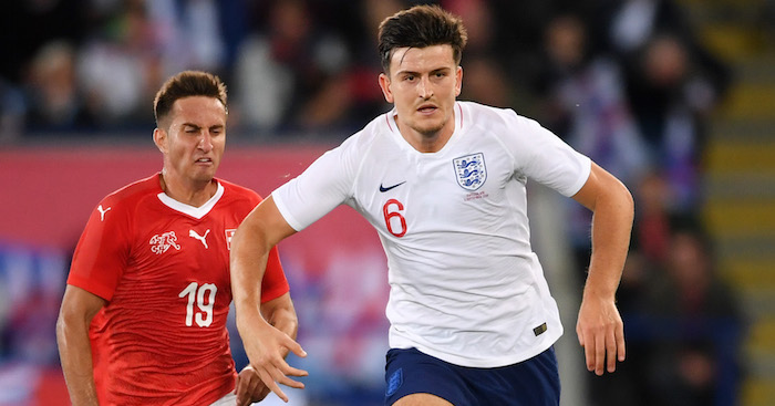 LEICESTER, ENGLAND - SEPTEMBER 11:  Harry Maguire of England is chased by Mario Gavranovic of Switzerland  during the international friendly match between England and Switzerland at The King Power Stadium on September 11, 2018 in Leicester, United Kingdom.  (Photo by Laurence Griffiths/Getty Images)