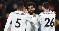 BOURNEMOUTH, ENGLAND - DECEMBER 17: Mohamed Salah of Liverpool celebrates with teammates Georginio Wijnaldum and Andy Robertson after scoring his sides third goal during the Premier League match between AFC Bournemouth and Liverpool at Vitality Stadium on December 17, 2017 in Bournemouth, England. (Photo by Catherine Ivill/Getty Images)