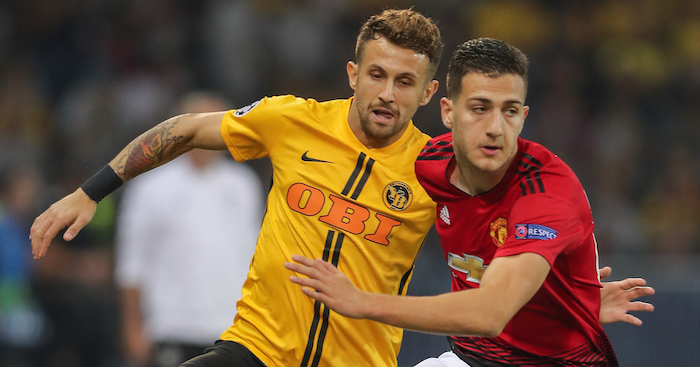 BERN, SWITZERLAND - SEPTEMBER 19: Diogo Dalot of Manchester United challenges Miralem Sulejmani of Berne during the Group H match of the UEFA Champions League between BSC Young Boys and Manchester United at Stade de Suisse, Wankdorf on September 19, 2018 in Bern, Switzerland. (Photo by Christian Kaspar-Bartke/Getty Images)