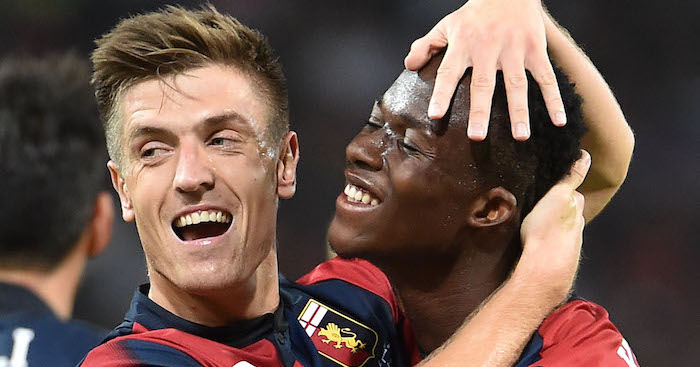 GENOA, GE - SEPTEMBER 26: Krzysztof Piatek of Genoa celebrates with Christian Kouam? after scoring 1-0 during the serie A match between Genoa CFC and Chievo Verona at Stadio Luigi Ferraris on September 26, 2018 in Genoa, Italy. (Photo by Paolo Rattini/Getty Images)