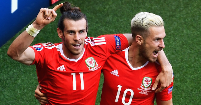 PARIS, FRANCE - JUNE 25: Gareth Bale (L) and Aaron Ramsey (R) of Wales celebrate their team's first goal during the UEFA EURO 2016 round of 16 match between Wales and Northern Ireland at Parc des Princes on June 25, 2016 in Paris, France. (Photo by Mike Hewitt/Getty Images)