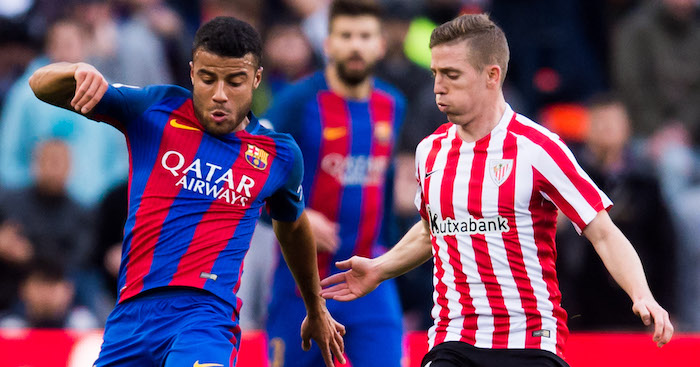 BARCELONA, SPAIN - FEBRUARY 04: Rafinha (L) of FC Barcelona protects the ball from Iker Muniain (R) of Athletic Club during the La Liga match between FC Barcelona and Athletic Club at Camp Nou stadium on February 4, 2017 in Barcelona, Spain. (Photo by Alex Caparros/Getty Images)