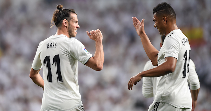 MADRID, SPAIN - SEPTEMBER 01: Gareth Bale of Real Madrid celebrates with Henrique Casemiro after scoring his team's opening goal during the La Liga match between Real Madrid CF and CD Leganes at Estadio Santiago Bernabeu on September 1, 2018 in Madrid, Spain. (Photo by Denis Doyle/Getty Images)