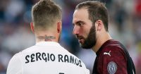 MADRID, SPAIN - AUGUST 11: Gonzalo Higuain (R) of AC Milan speaks with Sergio Ramos of Real Madrid CF after the Santiago Bernabeu Trophy between Real Madrid CF and AC Milan at Estadio Santiago Bernabeu on August 11, 2018 in Madrid, Spain. (Photo by Gonzalo Arroyo Moreno/Getty Images)
