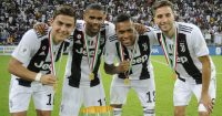 JEDDAH, SAUDI ARABIA - JANUARY 16: Paulo Dybala of Juventus celebrates with team mates Douglas Costa, Alex Sandro and Rodrigo Bentancur after winning the Italian Supercup match between Juventus and AC Milan at King Abdullah Sports City on January 16, 2019 in Jeddah, Saudi Arabia. (Photo by Marco Rosi/Getty Images for Lega Serie A)