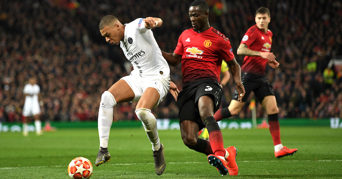 MANCHESTER, ENGLAND - FEBRUARY 12: Kylian Mbappe of PSG is tackled by Eric Bailly of Manchester United during the UEFA Champions League Round of 16 First Leg match between Manchester United and Paris Saint-Germain at Old Trafford on February 12, 2019 in Manchester, England. (Photo by Michael Regan/Getty Images)