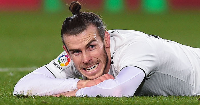 BARCELONA, SPAIN - FEBRUARY 06: Gareth Bale of Real Madrid CF reacts on the pitch after missing a chance to score during the Copa del Semi Final first leg match between Barcelona and Real Madrid at Nou Camp on February 06, 2019 in Barcelona, Spain. (Photo by Alex Caparros/Getty Images)