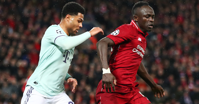 LIVERPOOL, ENGLAND - FEBRUARY 19: Sadio Mane of Liverpool battles with Serge Gnabry of Bayern Munich during the UEFA Champions League Round of 16 First Leg match between Liverpool and FC Bayern Muenchen at Anfield on February 19, 2019 in Liverpool, England. (Photo by Clive Brunskill/Getty Images)