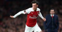 LONDON, ENGLAND - FEBRUARY 21: Mesut Ozil of Arsenal runs with the ball during the UEFA Europa League Round of 32 Second Leg match between Arsenal and BATE Borisov at Emirates Stadium on February 21, 2019 in London, United Kingdom. (Photo by Clive Rose/Getty Images)