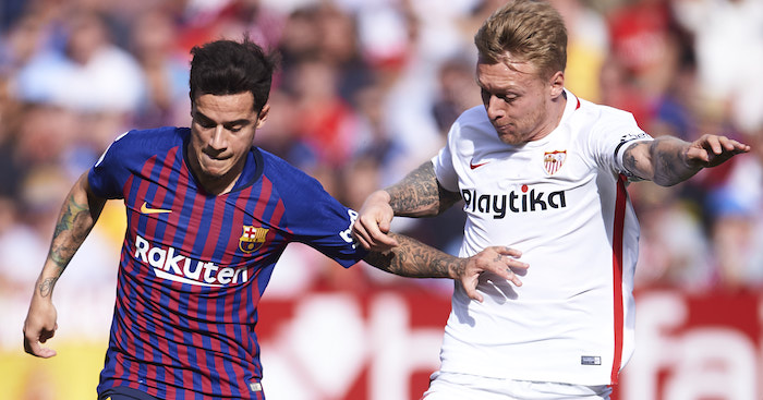 SEVILLE, SPAIN - FEBRUARY 23: Philippe Coutinho of FC Barcelona duels for the ball with Simon Kjaer of Sevilla FC during the La Liga match between Sevilla FC and FC Barcelona at Estadio Ramon Sanchez Pizjuan on February 23, 2019 in Seville, Spain. (Photo by Aitor Alcalde/Getty Images)