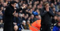 Hull City's Portuguese head coach Marco Silva (L) and Liverpool's German manager Jurgen Klopp gesture on the touchline during the English Premier League football match between Hull City and Liverpool at the KCOM Stadium in Kingston upon Hull, north east England on February 4, 2017. / AFP / Lindsey PARNABY / RESTRICTED TO EDITORIAL USE. No use with unauthorized audio, video, data, fixture lists, club/league logos or 'live' services. Online in-match use limited to 75 images, no video emulation. No use in betting, games or single club/league/player publications. / (Photo credit should read LINDSEY PARNABY/AFP/Getty Images)
