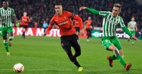 Rennes' French forward Hatem Ben Arfa (C) vies with Real Betis' spanish midfielder Giovanni Lo Celso during the UEFA Europa League round of 32 first-leg football match between Rennes and Real Betis at the Roazhon Park stadium in Rennes, western France, on February 14, 2019. (Photo by DAMIEN MEYER / AFP) (Photo credit should read DAMIEN MEYER/AFP/Getty Images)