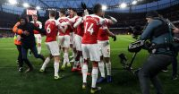 LONDON, ENGLAND - MARCH 10: Pierre-Emerick Aubameyang of Arsenal celebrates with teammates after scoring his team's second goal as a pitch invader is escorted away by stewards during the Premier League match between Arsenal FC and Manchester United at Emirates Stadium on March 10, 2019 in London, United Kingdom. (Photo by Julian Finney/Getty Images)