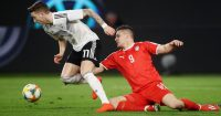 Marco Reus of Germany and Luka Jovic of Serbia