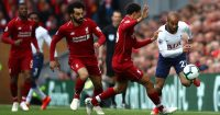 LIVERPOOL, ENGLAND - MARCH 31: Lucas Moura of Tottenham Hotspur is chased by Trent Alexander-Arnold and Mohamed Salah of Liverpool during the Premier League match between Liverpool FC and Tottenham Hotspur at Anfield on March 31, 2019 in Liverpool, United Kingdom. (Photo by Clive Brunskill/Getty Images)