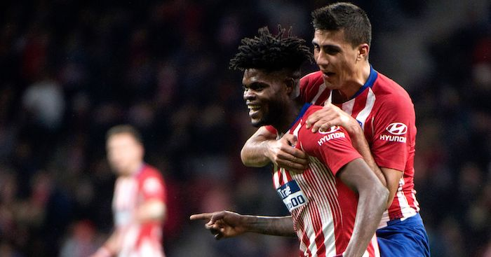 Atletico Madrid's Ghanaian midfielder Thomas (C) celebrates with Atletico Madrid's Spanish midfielder Rodri after scoring a goal during the Spanish league football match between Club Atletico de Madrid and Athletic Club Bilbao at the Wanda Metropolitano stadium in Madrid on November 10, 2018. (Photo by CURTO DE LA TORRE / AFP) (Photo credit should read CURTO DE LA TORRE/AFP/Getty Images)