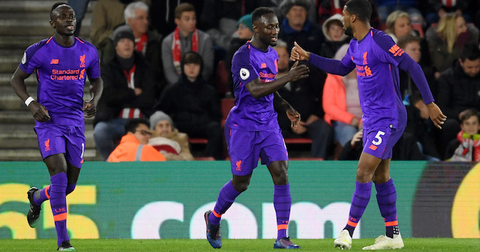 SOUTHAMPTON, ENGLAND - APRIL 05: Naby Keita of Liverpool celebrates with team mate Georginio Wijnaldum of Liverpool after scoring their team's first goal during the Premier League match between Southampton FC and Liverpool FC at St Mary's Stadium on April 05, 2019 in Southampton, United Kingdom. (Photo by Mike Hewitt/Getty Images)