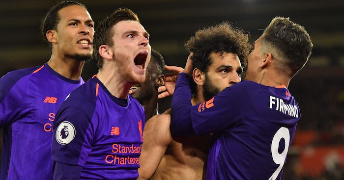 Liverpool's Egyptian midfielder Mohamed Salah (2nd R) celebrates with teammates after scoring their second goal during the English Premier League football match between Southampton and Liverpool at St Mary's Stadium in Southampton, southern England on April 5, 2019. (Photo by Glyn KIRK / AFP) / RESTRICTED TO EDITORIAL USE. No use with unauthorized audio, video, data, fixture lists, club/league logos or 'live' services. Online in-match use limited to 120 images. An additional 40 images may be used in extra time. No video emulation. Social media in-match use limited to 120 images. An additional 40 images may be used in extra time. No use in betting publications, games or single club/league/player publications. / (Photo credit should read GLYN KIRK/AFP/Getty Images)