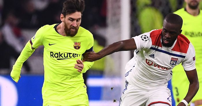 Barcelona's Argentinian forward Lionel Messi (L) vies for the ball next to Lyon's French forward Tanguy NDombele Alvaro (R) during the UEFA Champions League round of 16 first leg football match between Lyon (OL) and FC Barcelona on February 19, 2019, at the Groupama Stadium in Decines-Charpieu, central-eastern France. (Photo by FRANCK FIFE / AFP) (Photo credit should read FRANCK FIFE/AFP/Getty Images)