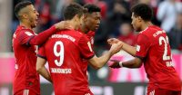 MUNICH, GERMANY - APRIL 06: Serge Gnabry of Muenchen celebrates scoring the 4th goal with his team mates David Alaba (2nd R), Robert Lewandowski (2nd L) and Thiago Alcantara (L) during the Bundesliga match between FC Bayern Muenchen and Borussia Dortmund at Allianz Arena on April 06, 2019 in Munich, Germany. (Photo by Alexander Hassenstein/Bongarts/Getty Images)