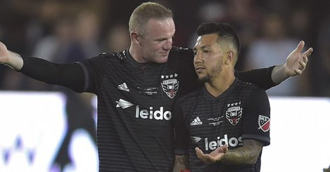 Wayne Rooney (L) of DC United celebrates with Luciano Acosta