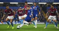 LONDON, ENGLAND - APRIL 08: Eden Hazard of Chelsea shoots past Ryan Fredericks of West Ham United during the Premier League match between Chelsea FC and West Ham United at Stamford Bridge on April 08, 2019 in London, United Kingdom. (Photo by Mike Hewitt/Getty Images)