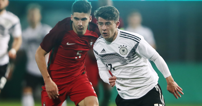 Mats Koehlert of Germany is challenged by Ruben Vinagre of Portugal
