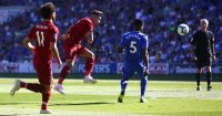 Liverpool's Brazilian midfielder Roberto Firmino (2L) takes a shot but misses the target during the English Premier League football match between between Cardiff City and Liverpool at Cardiff City Stadium in Cardiff, south Wales on April 21, 2019. (Photo by GEOFF CADDICK / AFP) / RESTRICTED TO EDITORIAL USE. No use with unauthorized audio, video, data, fixture lists, club/league logos or 'live' services. Online in-match use limited to 120 images. An additional 40 images may be used in extra time. No video emulation. Social media in-match use limited to 120 images. An additional 40 images may be used in extra time. No use in betting publications, games or single club/league/player publications. / (Photo credit should read GEOFF CADDICK/AFP/Getty Images)