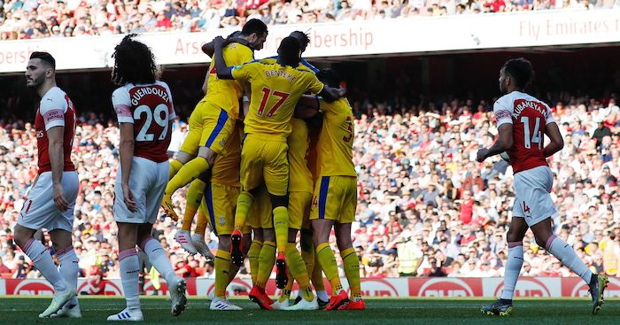 Crystal Palace players celebrate scoring their third goal during the English Premier League football match between Arsenal and Crystal Palace at the Emirates Stadium in London on April 21, 2019. (Photo by Adrian DENNIS / AFP) / RESTRICTED TO EDITORIAL USE. No use with unauthorized audio, video, data, fixture lists, club/league logos or 'live' services. Online in-match use limited to 120 images. An additional 40 images may be used in extra time. No video emulation. Social media in-match use limited to 120 images. An additional 40 images may be used in extra time. No use in betting publications, games or single club/league/player publications. / (Photo credit should read ADRIAN DENNIS/AFP/Getty Images)