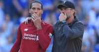 CARDIFF, WALES - APRIL 21: Jurgen Klopp, Manager of Liverpool and Virgil van Dijk in discussion after the Premier League match between Cardiff City and Liverpool FC at Cardiff City Stadium on April 21, 2019 in Cardiff, United Kingdom. (Photo by Mike Hewitt/Getty Images)