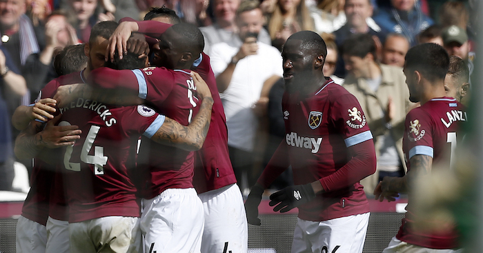 West Ham United's English defender Ryan Fredericks (L) is mobbed by teammates after scoring his team's third goal during the English Premier League football match between West Ham United and Southampton at The London Stadium, in east London on May 4, 2019. (Photo by Ian KINGTON / AFP) / RESTRICTED TO EDITORIAL USE. No use with unauthorized audio, video, data, fixture lists, club/league logos or 'live' services. Online in-match use limited to 120 images. An additional 40 images may be used in extra time. No video emulation. Social media in-match use limited to 120 images. An additional 40 images may be used in extra time. No use in betting publications, games or single club/league/player publications. / (Photo credit should read IAN KINGTON/AFP/Getty Images)