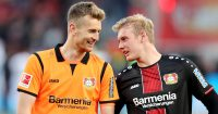 LEVERKUSEN, GERMANY - MAY 05: Julian Brandt of Bayer 04 Leverkusen celebrates with teammate Lukas Hradecky after winning the Bundesliga match between Bayer 04 Leverkusen and Eintracht Frankfurt at BayArena on May 05, 2019 in Leverkusen, Germany. (Photo by Christof Koepsel/Bongarts/Getty Images)