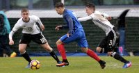 VILA REAL SANTO ANTÓNIO, PORTUGAL - FEBRUARY 11: Julian Albrecht (L) and Oscar Schönfelder (R) of Germany U16 challenge Bilel Hassaini (C) of France U16 during the UEFA Development Tournament Match between Germany U16 and France U16 on February 11, 2017 in Vila Real Santo António, Portugal. (Photo by Filipe Farinha/Getty Images)