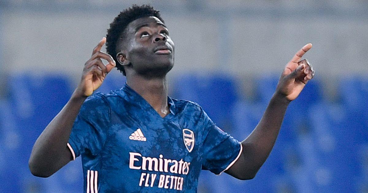 Bukayo Saka celebrates scoring a goal for Arsenal against Benfica.