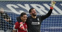 Roberto Firmino and Alisson Becker of Liverpool