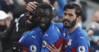 Christian Benteke, Cheikhou Kouyate and James Tomkins celebrating for Crystal Palace, May 2021