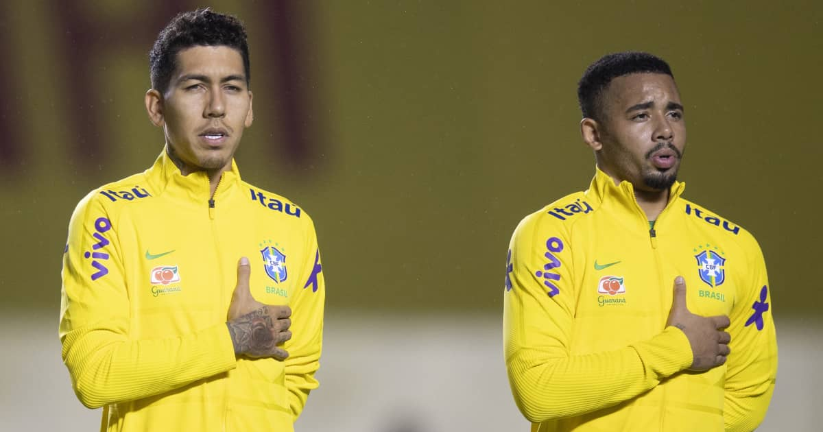 Roberto Firmino and Gabriel Jesus lining up for the Brazil national anthem
