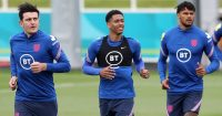 Harry Maguire, Jude Bellingham and Tyrone Mings warming up for England ahead of EURO 2020