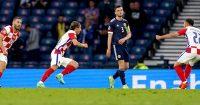 Andy Robertson, Scotland watches on as Luka Modric celebrates his goal for Croatia, TEAMtalk
