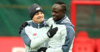Xherdan Shaqiri embracing Sadio Mane in Liverpool training, 2019