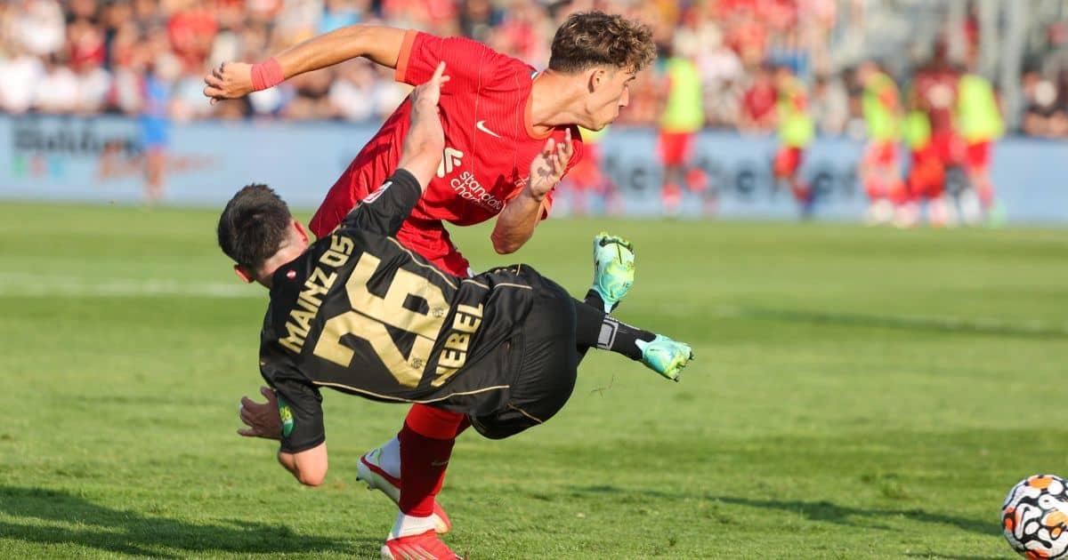 Kostas Tsimikas fights for the ball
