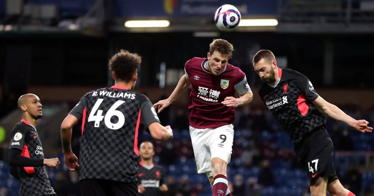 Liverpool's Nathaniel Phillips competes with Burnley's Chris Wood