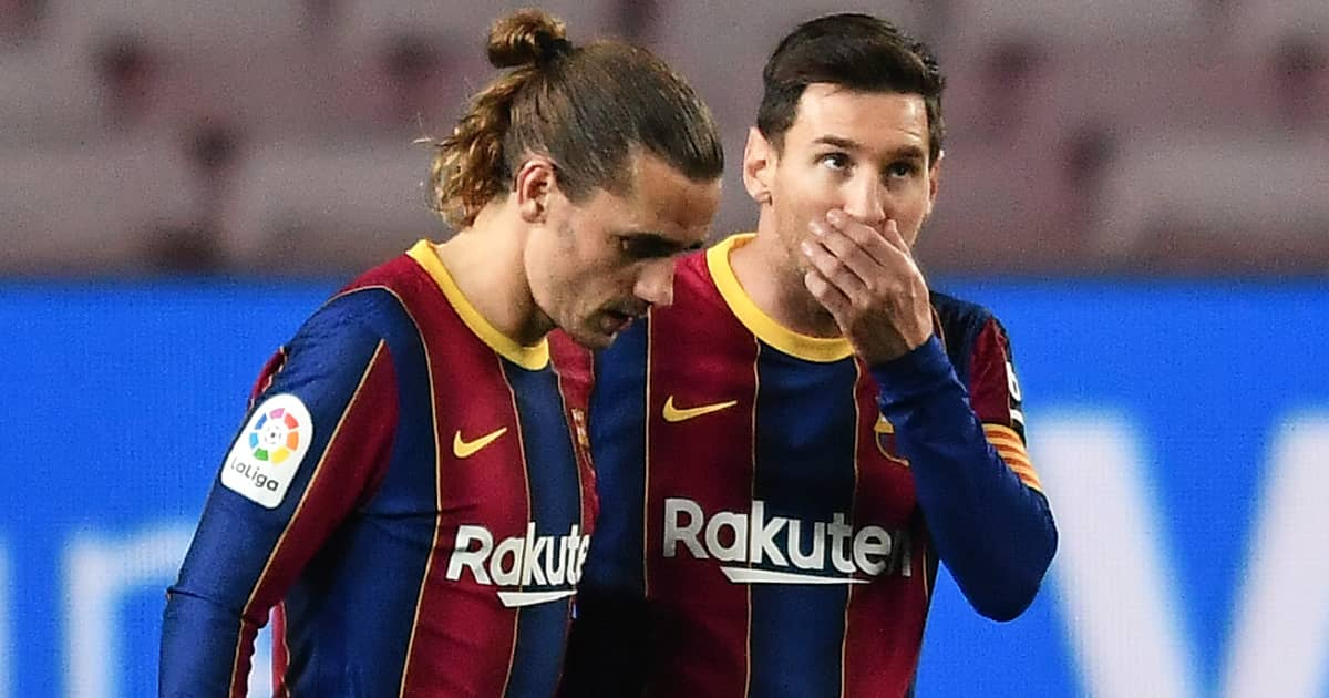 Barcelona team-mates Antoine Griezmann and Lionel Messi during a La Liga match in 2021