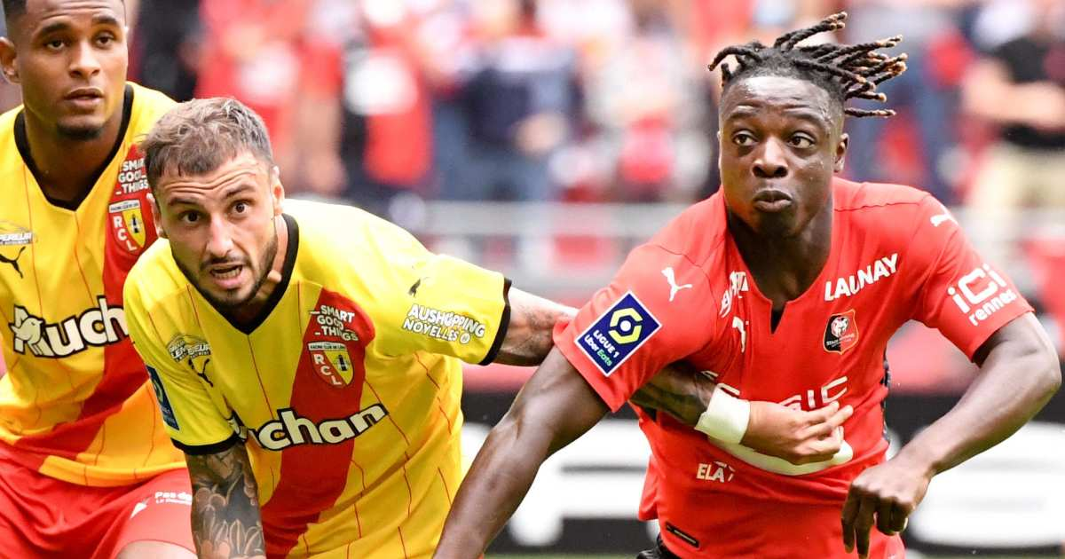 Jonathan Clauss of Lens tussles with Jeremy Doku of Rennes